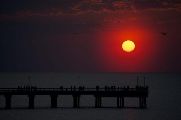 Saulėlydis nuo Palangos tilto
